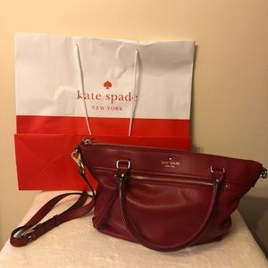 Cranberry red genuine Kate Spade crossbody bag.